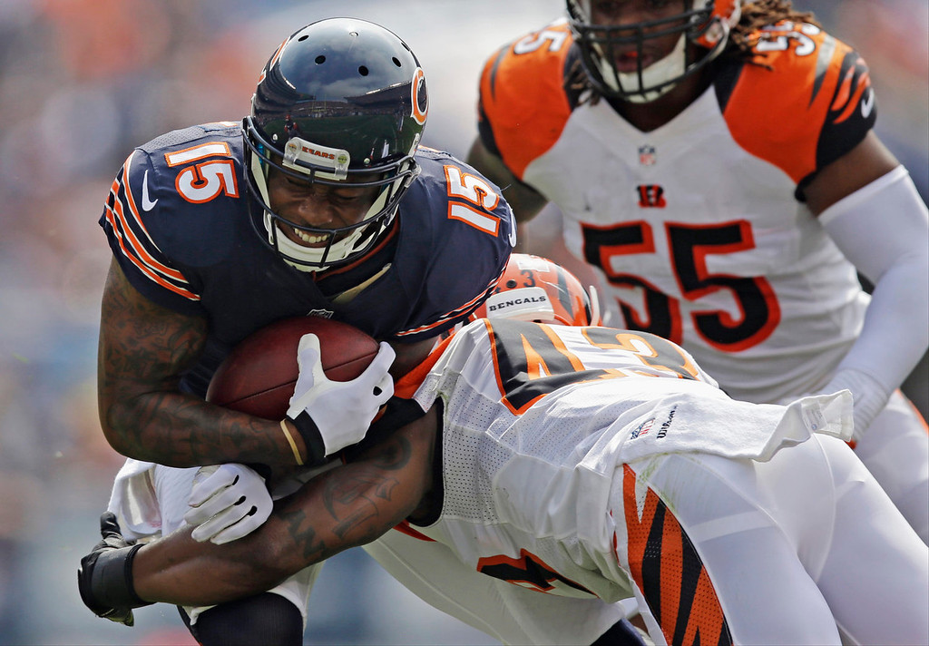 . Chicago Bears wide receiver Brandon Marshall (15) is tackled by Cincinnati Bengals safety George Iloka (43) during the first half of an NFL football game, Sunday, Sept. 8, 2013, in Chicago. (AP Photo/Nam Y. Huh)