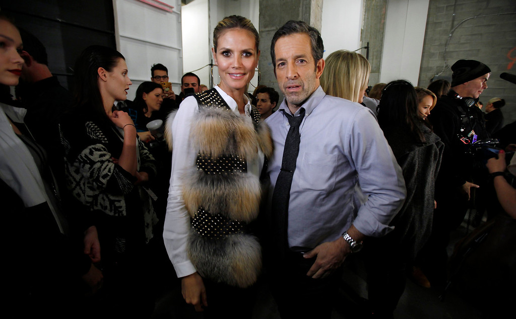. Supermodel Heidi Klum and designer Kenneth Cole pose for a photo before the Kenneth Cole Autumn/Winter 2013 collection during New York Fashion Week in New York, February 7, 2013.   REUTERS/Carlo Allegri