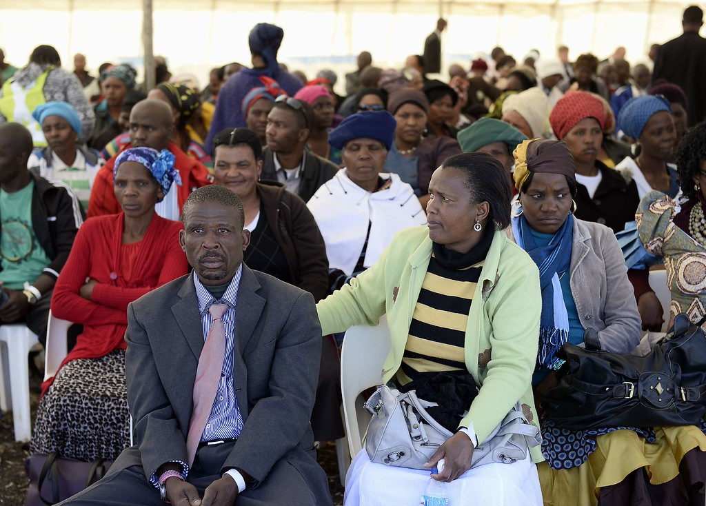 . Relatives of 34 miners shot dead by South African police during a violent wage strike attend a memorial service on August 16, 2013 in Marikana to mark the first anniversary of their deaths. Today marks a year after police opened fire on thousands of strikers at platinum producer Lonmin\'s mine, northwest of Johannesburg, which killed 34 and injured 78 people. The August shooting was described as the worst police brutality since the end of apartheid two decades ago. Three days ago, the firm has recognised radical labour group AMCU, which led the wage strike, in an attempt to ease simmering inter-union tensions on the platinum belt. STEPHANE DE SAKUTIN/AFP/Getty Images