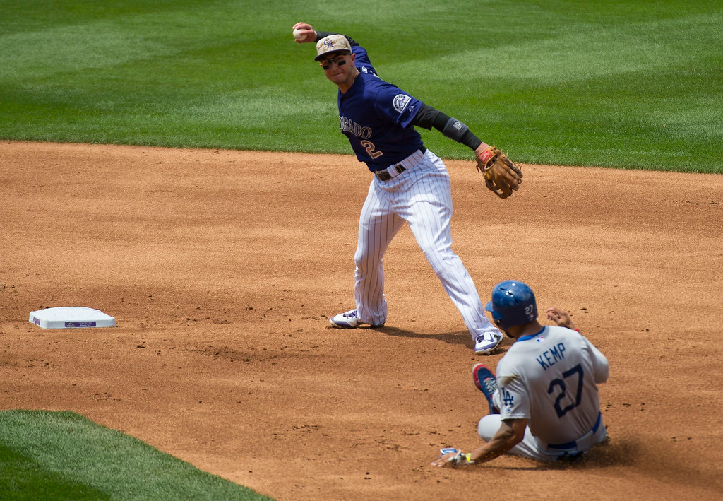 . Los Angeles Dodgers center fielder Matt Kemp (27) is forced at second base by Colorado Rockies shortstop Troy Tulowitzki (2) as he throws to first baseman Colorado Rockies first baseman Justin Morneau (33) for the double play July 6, 2014 at Coors Field. (Photo by John Leyba/The Denver Post)