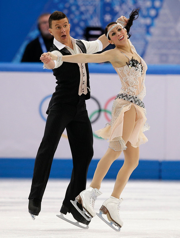 . Charlene Guignard and Marco Fabbri of Italy compete in the ice dance short dance figure skating competition at the Iceberg Skating Palace during the 2014 Winter Olympics, Sunday, Feb. 16, 2014, in Sochi, Russia. (AP Photo/Darron Cummings)