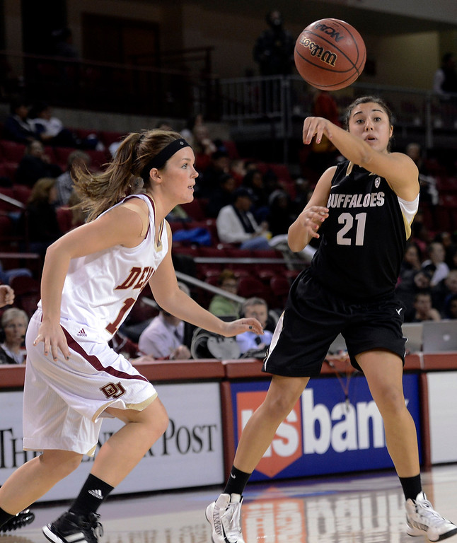 . University of Colorado\'s Jasmine Sborov passes the ball in front of Morgan Van Riper-Rose during a games against the University of Denver on Tuesday, Dec. 11, at the Magnus Arena on the DU campus in Denver.   (Jeremy Papasso/Daily Camera)