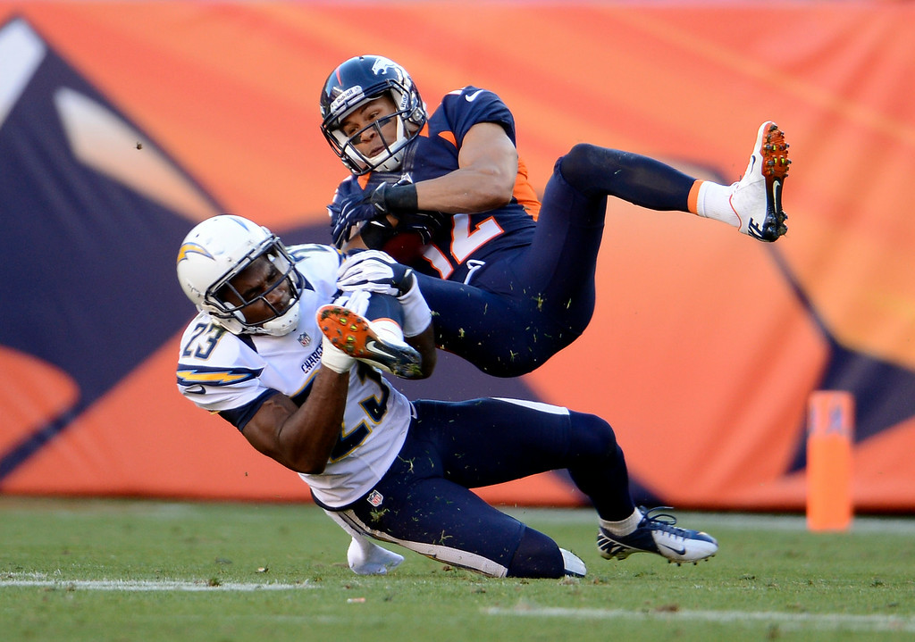 . Former Broncos wide receiver Matt Willis is taken down by Quentin Jammer. (John Leyba, The Denver Post)