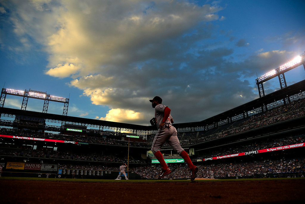 . Denard Span (2) of the Washington Nationals runs onto the field against the Colorado Rockies at Coors Field. Major League Baseball action between the Colorado Rockies and the Washington Nationals on Monday, July 21, 2014. (Photo by AAron Ontiveroz/The Denver Post)