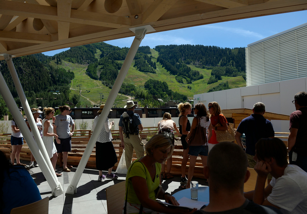 . The Aspen ski area can be seen from the rooftop patio of the new museum. The Aspen Art Museum celebrates its grand opening to the public on Saturday, Aug. 2, 2014. The architect on the project, Shigeru Ban, was there for the celebration which included an official ribbon cutting and fireworks. (Photo by Kathryn Scott Osler/The Denver Post)