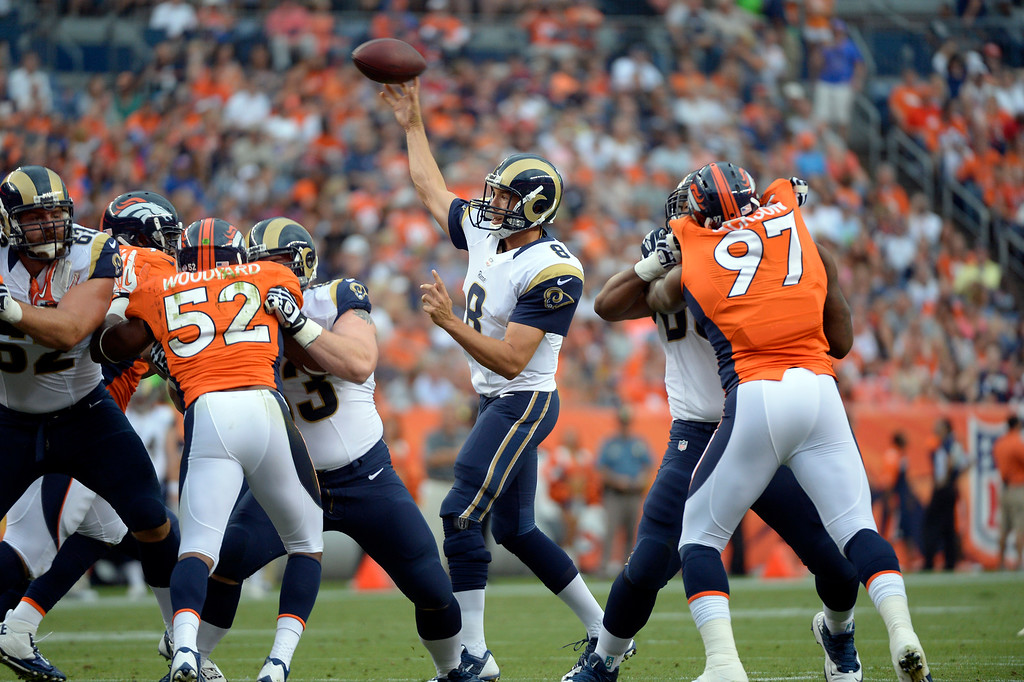. DENVER, CO. - AUGUST 17: St. Louis Rams quarterback Sam Bradford (8) drops back to pass during the second quarter  August 24, 2013 at Sports Authority Field at Mile High. (Photo By John Leyba/The Denver Post)