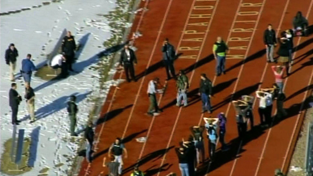 """. In this framegrab taken from video by KCNC television news in Denver, students of Arapahoe High School in Centennial, Colorado, line up to be checked by police at a running track on December 13, 2013 after a shooting at the school. Two students were injured in the shooting incident before the suspected gunman apparently killed himself, the local sheriff said. The suspect was also a student. \""""That individual is .. deceased, he apparently killed himself,\"""" Arapahoe County Sheriff Grayson Robinson told reporters.     AFP PHOTO / KCNC /AFP/Getty Images"""