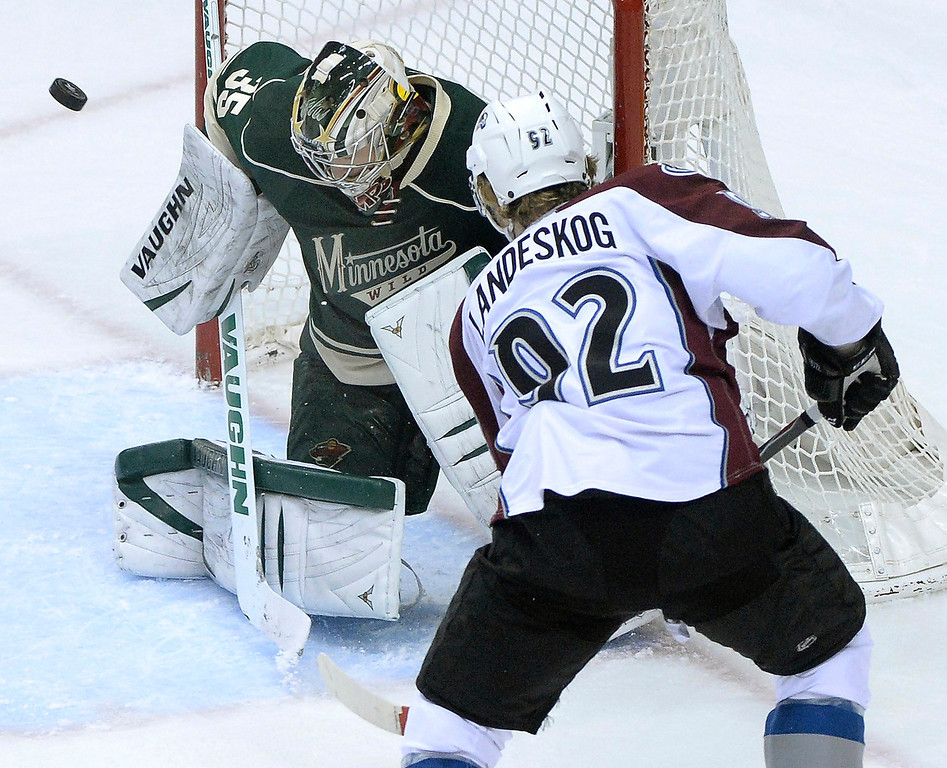 . Minnesota goalie Darcy Kuemper made a save on a shot from Colorado wing Gabriel Landeskog while the Avs were on a power play in the first period. (Photo by Karl Gehring/The Denver Post)