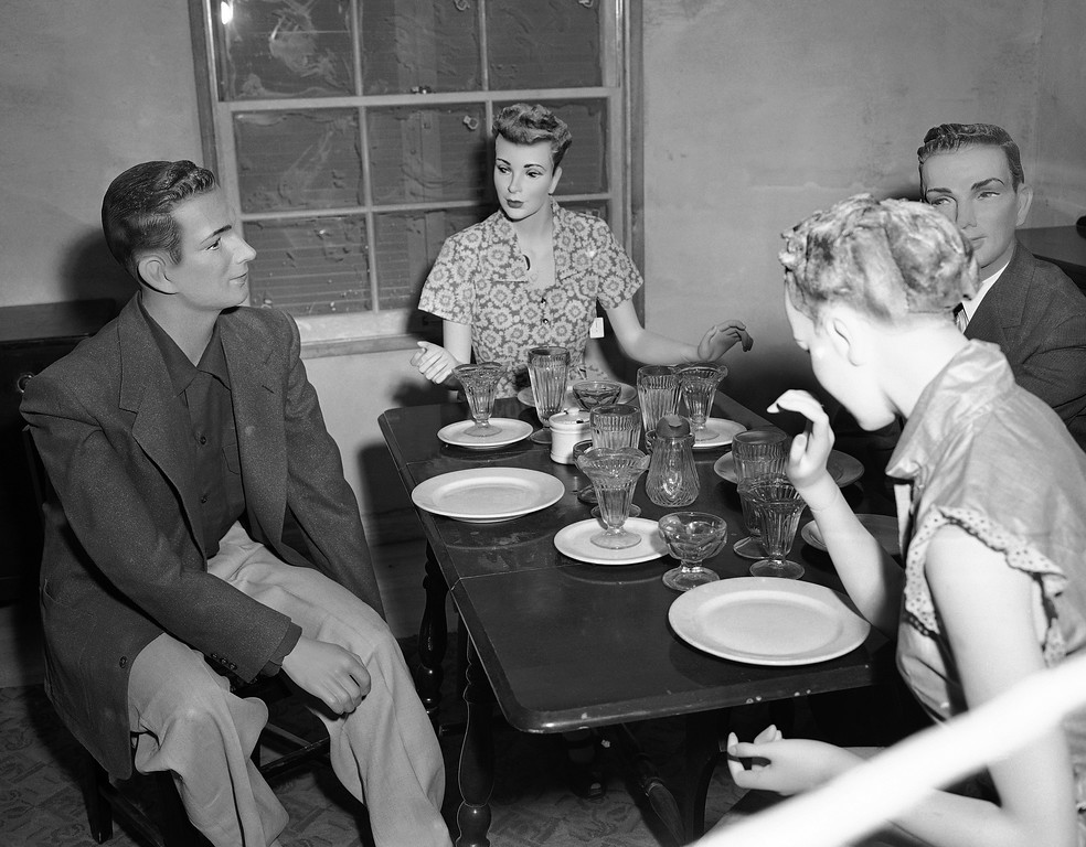 ". Mannequins seated at a table in the dining room of house number two, attend a ""dinner party\"" thrown by Civil Defense officials that are testing the effects of an atomic explosion on houses and occupants on March 15, 1953. The first in a series will be held at the atomic proving grounds near Las Vegas, Nev. No one knows what will happen when the bomb goes off a mile and a half away, but officials hope most of this will remain standing. (AP Photo/Dick Strobel)"