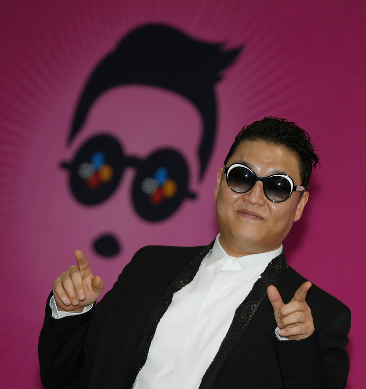 """. South Korean rapper Psy poses during a news conference before his concert in Seoul April 13, 2013. Psy will perform \""""Gentleman\"""" in public for the first time on Saturday at a concert at Seoul\'s World Cup stadium but he has been coy about what dance to expect this time, except to hint that it is based on traditional Korean moves. Psy released his new single on Thursday hoping to repeat the success of \""""Gangnam Style\"""" that made him the biggest star to emerge from the growing K-pop music scene.  REUTERS/Lee Jae-Won"""