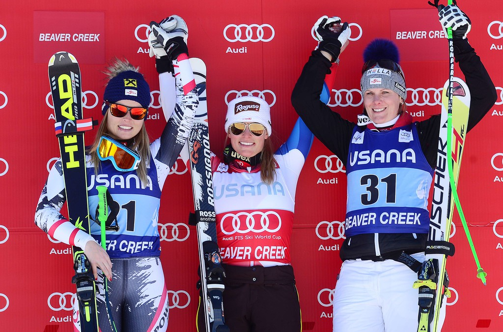 . Switzerland\'s Lara Gut (C), first place; Austria\'s Anna Fenninger (L), second place; and Austria\'s Nicole Hosp, third place, celebrate on the winners\' podium of the women\'s super G race at the FIS Ski World Cup in Beaver Creek, Colorado, November, 30, 2013. AFP PHOTO/Emmanuel DUNAND/AFP/Getty Images