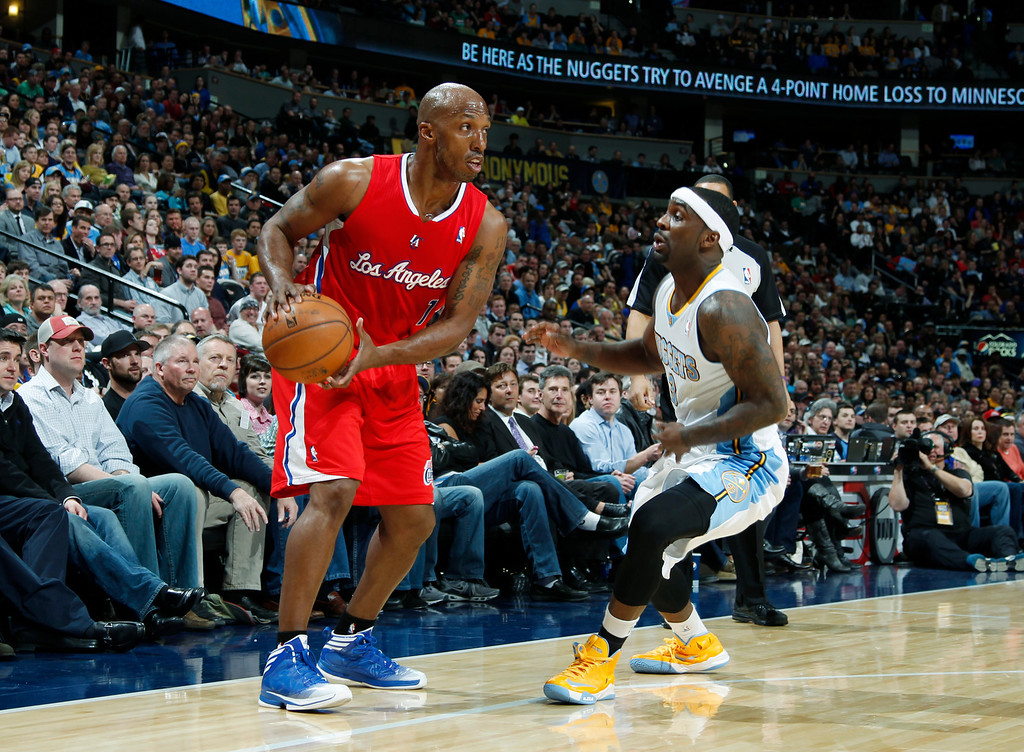 . Los Angeles Clippers guard Chauncey Billups, left, looks to pass the ball as Denver Nuggets guard Ty Lawson covers in the first quarter of an NBA basketball game in Denver, Thursday, March 7, 2013. (AP Photo/David Zalubowski)