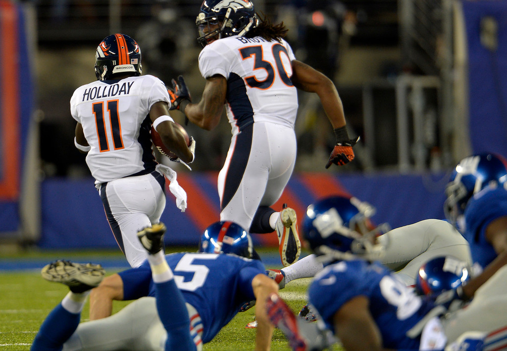 . September 15: Wide receiver Trindon Holliday (11) of the Denver Broncos leaves the New York Giants behind on this 81 yard punt return for a touchdown to make the score 37-16 at METLIFE Stadium. September 15, 2013 East Rutherford, NJ. (Photo By Joe Amon/The Denver Post)