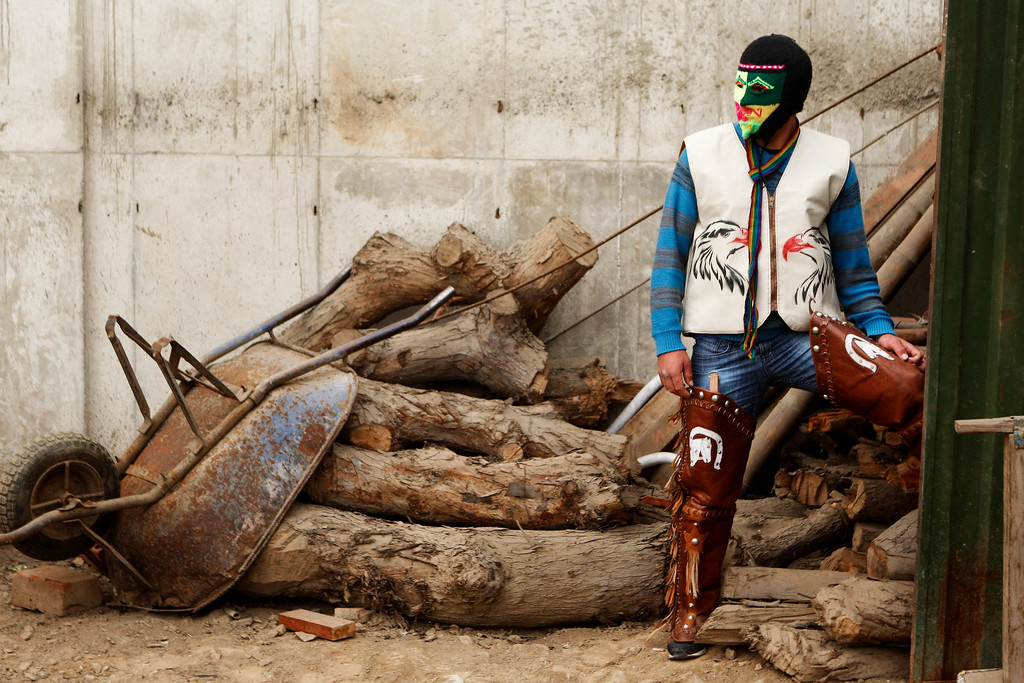 """. Masked fighter Alejandro Alvaro wears his costume before taking part in an Andean fight known as Takanakuy in Lima, Peru. Takanakuy, which means \""""When the blood is boiling\"""" in Quechua, is a ritual of unclear providence that predates Spanish colonial rule and happens twice a year, in July and just after Christmas, to settle scores. (AP Photo/Karel Navarro)"""
