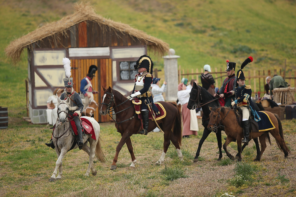 . Historical society enthusiasts in the role of French Cuirassiers fighting under Napoleon arrive to re-enact The Battle of Nations on its 200th anniversary on October 20, 2013 near Leipzig, Germany. (Photo by Sean Gallup/Getty Images)
