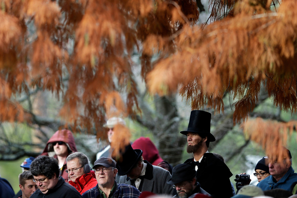 . A re-enactor stands with audience members during a ceremony commemorating the 150th anniversary of the dedication of the Soldiers\' National Cemetery and President Abraham Lincoln\'s Gettysburg Address, Tuesday, Nov. 19, 2013, in Gettysburg, Pa.  (AP Photo/Matt Rourke)