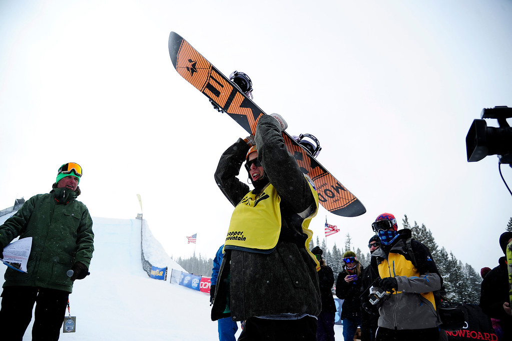 . Champion Staale Sandbech hoists his board in celebration following the slopestyle finals of the Copper Mountain Grand Prix.   (Photo by AAron Ontiveroz/The Denver Post)