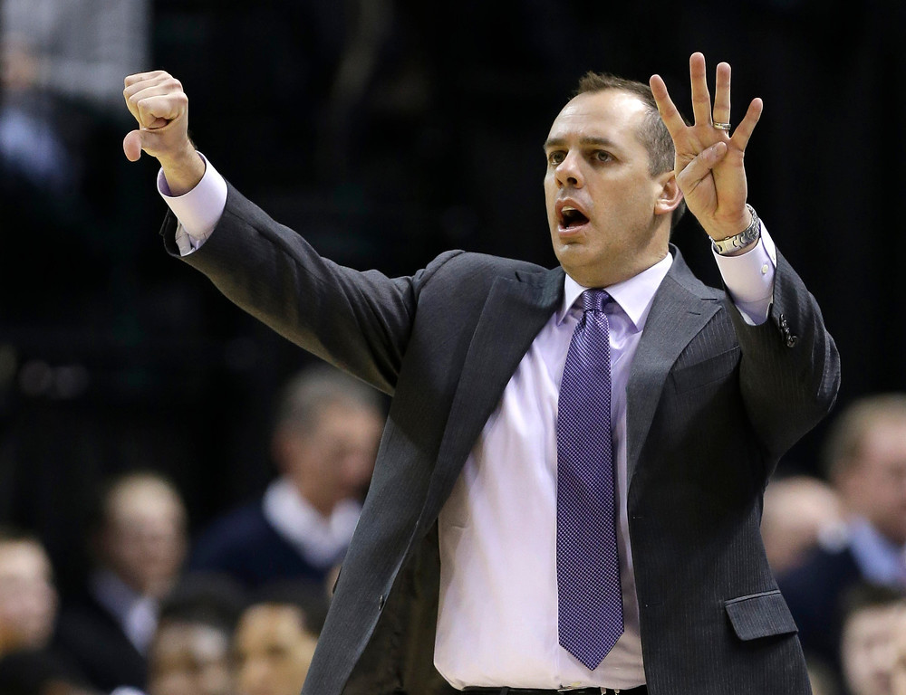 . Indiana Pacers head coach Frank Vogel calls a play to his team in the second half of an NBA basketball game against the Denver Nuggets in Indianapolis, Monday, Feb. 10, 2014. The Pacers won 119-80. (AP Photo/Michael Conroy)