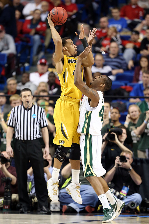 . LEXINGTON, KY - MARCH 21:  Laurence Bowers #21 of the Missouri Tigers shoots the ball over Greg Smith #44 of the Colorado State Rams during the second round of the 2013 NCAA Men\'s Basketball Tournament at the Rupp Arena on March 21, 2013 in Lexington, Kentucky.  (Photo by Andy Lyons/Getty Images)