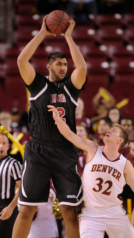 . DENVER, CO. - MARCH 2: Aggies center Sim Bhullar (2) kept the ball from Denver defender Shase Hallam (32) in the first half. The University of Denver men\'s basketball team defeated New Mexico State 66-60 Saturday evening, March 2, 2013 at Magness Arena. (Photo By Karl Gehring/The Denver Post)