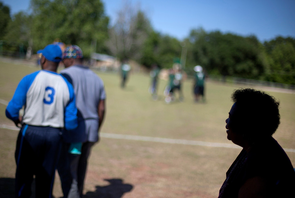 """. Shirley Ann Jordan, right, watches her son Jimmie Burnette, left, play blind baseball for the first time since he lost his vision to a brain tumor in 2010, in Albany, Ga. on May 5, 2012. \""""I was brought up with the attitude of a man doesn\'t work he doesn\'t eat. A man provides for his family and his home. I kept saying to myself you\'re not a man anymore, you\'re not a man anymore. Now I realize I\'m still the same man, just have to do things differently now,\"""" says Burnette. (AP Photo/David Goldman)"""