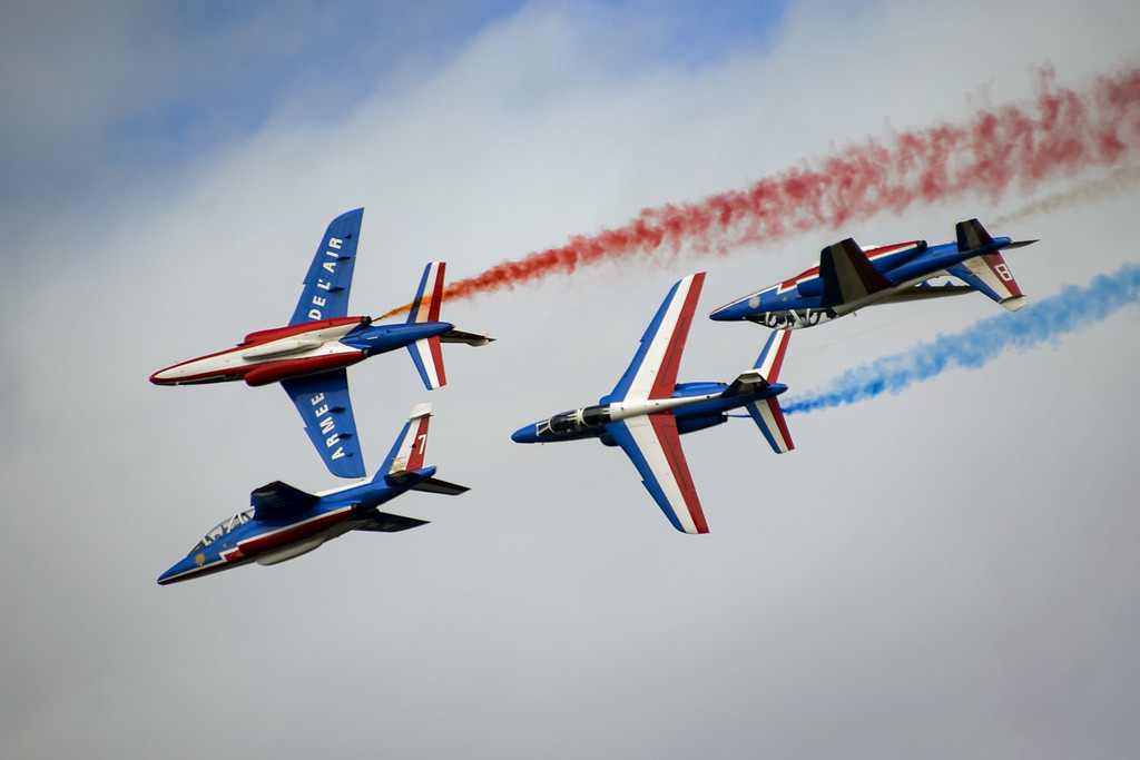 """. Fighter jets of the \""""The Patrouille de France\"""" perform during the first day of AIR14 air show on August 30, 2014 in Payerne, western Switzerland.  AFP PHOTO / FABRICE COFFRINI/AFP/Getty Images"""
