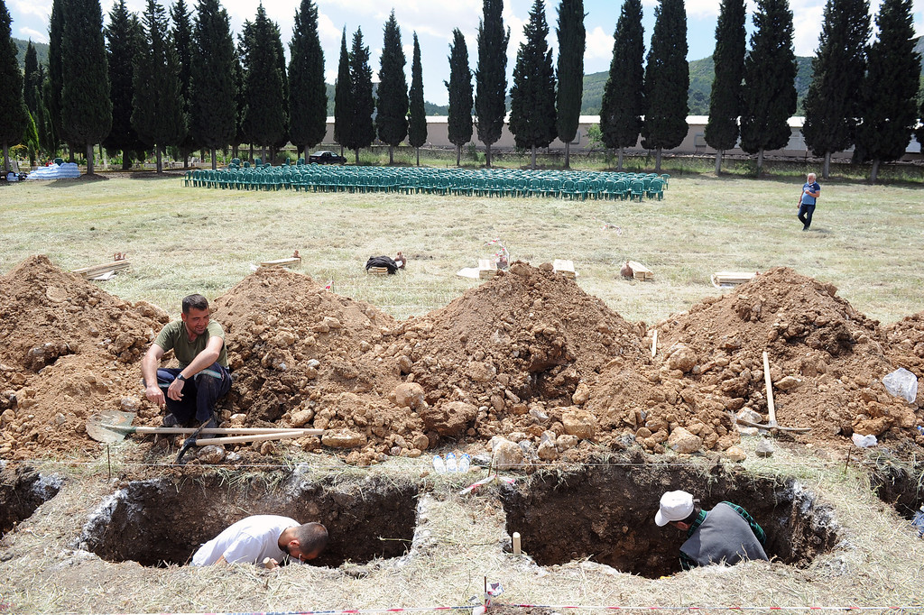 . People prepare graves for the mine accident victims in Soma, Turkey, Thursday, May 15, 2014. An explosion and fire at a coal mine in Soma, some 250 kilometers (155 miles) south of Istanbul, killed hundreds of workers, authorities said, in one of the worst mining disasters in Turkish history.(AP Photo/Emre Tazegul)