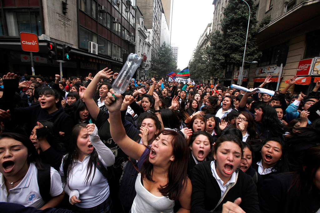 . Chilean students march through the streets demanding free education, in Santiago, Chile, Thursday, April. 11, 2013.  The marches began during the 2006-2010 Michelle Bachelet administration and have troubled current President Sebastian Pinera even more. Pinera\'s government is focusing a chunk of the 2013 budget on financing school loans at lower rates. But students say the system still fails them, with poor public schools, expensive private universities, unprepared teachers and unaffordable loans. (AP Photo/Luis Hidalgo)