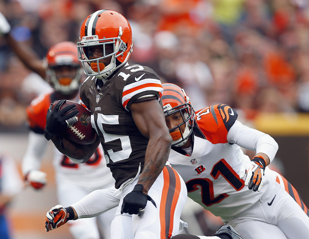 . CLEVELAND, OH - SEPTEMBER 29:  Wide receiver Davone Bess #15 of the Cleveland Browns runs the ball by cornerback Brandon Ghee #21 of the Cincinnati Bengals at FirstEnergy Stadium on September 29, 2013 in Cleveland, Ohio.  (Photo by Matt Sullivan/Getty Images)