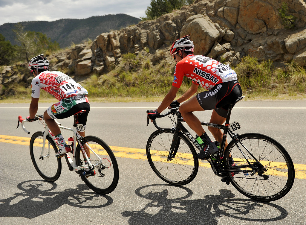 . Luis Lemus of Jelly Belly Cycling p/b Kenda, left, and Matt Cooke of Jamis-Hagens Berman p/b Sutter Home are heading toward Fairplay en route to Breckenridge during the second stage of the reace. (Photo By Hyoung Chang/The Denver Post)
