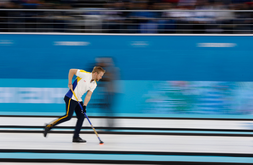 . Sweden\'s skip Niklas Edin cleans his path before delivering the rock during the men\'s curling bronze medal game against China at the 2014 Winter Olympics, Friday, Feb. 21, 2014, in Sochi, Russia. (AP Photo/Robert F. Bukaty)
