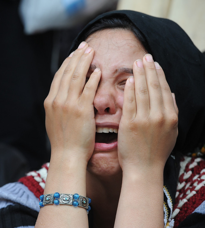 . A woman cries during the burial of a mine accident victim in Soma, Turkey, Thursday, May 15, 2014. An explosion and fire at a coal mine in Soma, some 250 kilometers (155 miles) south of Istanbul, killed hundreds of workers, authorities said, in one of the worst mining disasters in Turkish history.(AP Photo/Emre Tazegul)