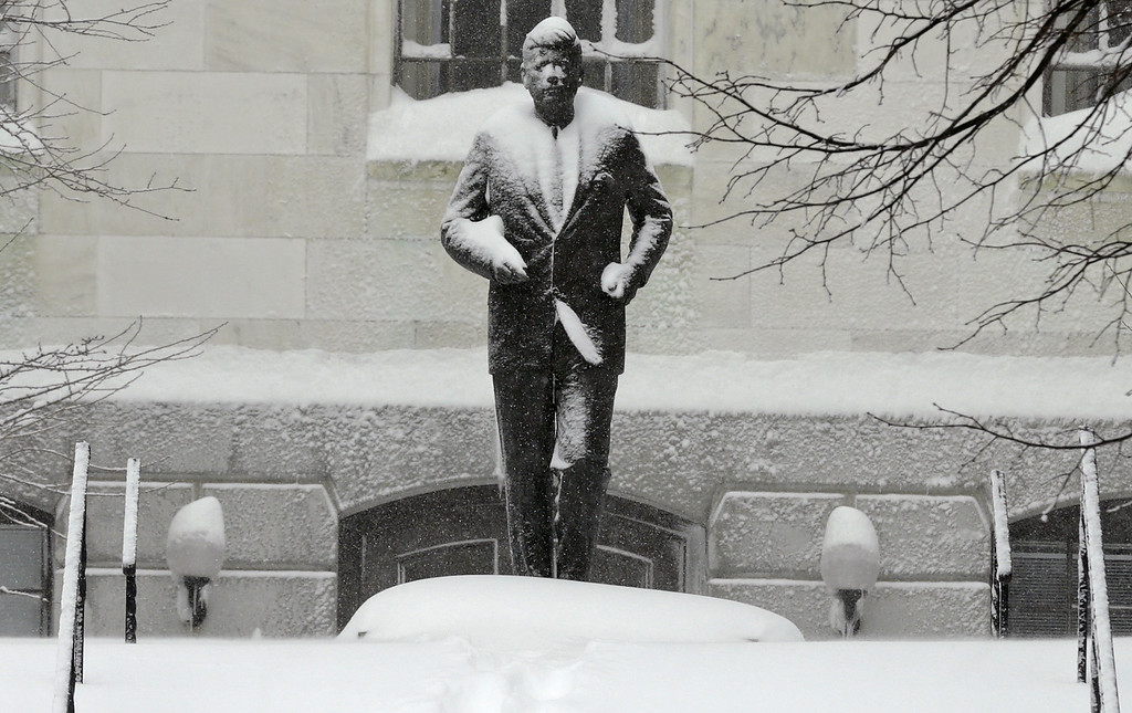. The statue of President Kennedy is covered with snow outside the Statehouse on Beacon Hill in Boston, Saturday, Feb. 9, 2013. The Boston area received about two feet of snow from a winter storm. A howling storm across the Northeast left the New York-to-Boston corridor shrouded in 1 to 3 feet of snow Saturday, stranding motorists on highways overnight and piling up drifts so high that some homeowners couldn\'t get their doors open. More than 650,000 homes and businesses were left without electricity. (AP Photo/Charles Krupa)