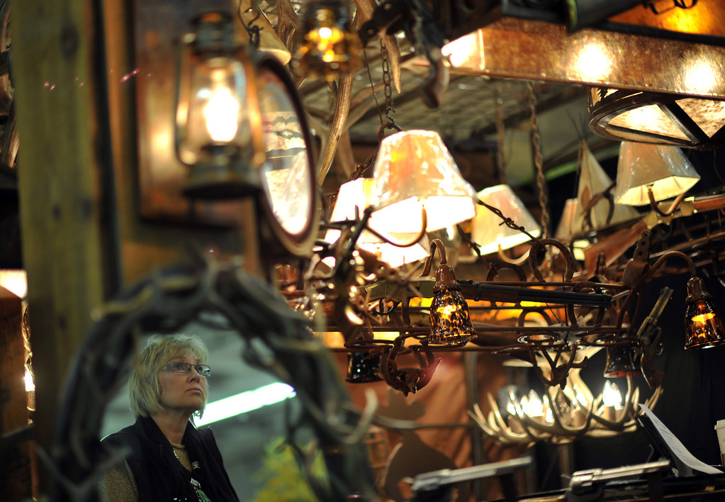 . Janet Wells from Colby, KA. is checking the custom handmade lamps from Creekside County Enterprises at Expo Hall of 2013 Nationl Wester Stock Show on Tuesday. Denver. CO, January 15, 2013.  Hyoung Chang, The Denver Post