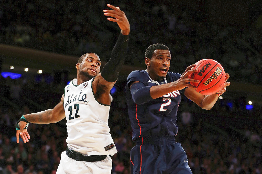. DeAndre Daniels #2 of the Connecticut Huskies grabs a rebound against Branden Dawson #22 of the Michigan State Spartans during the East Regional Final of the 2014 NCAA Men\'s Basketball Tournament at Madison Square Garden on March 30, 2014 in New York City.  (Photo by Elsa/Getty Images)
