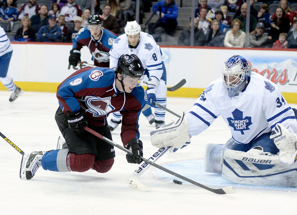 . DENVER, CO. - JANUARY 21:  Avalanche center Matt Duchene (9) was tripped as he made a move toward Toronto goalie James Reimer (34) in the third period. The Toronto Maple Leafs defeated the Colorado Avalanche 5-2 Tuesday night, January 21, 2014 at the Pepsi Center. Photo By Karl Gehring/The Denver Post