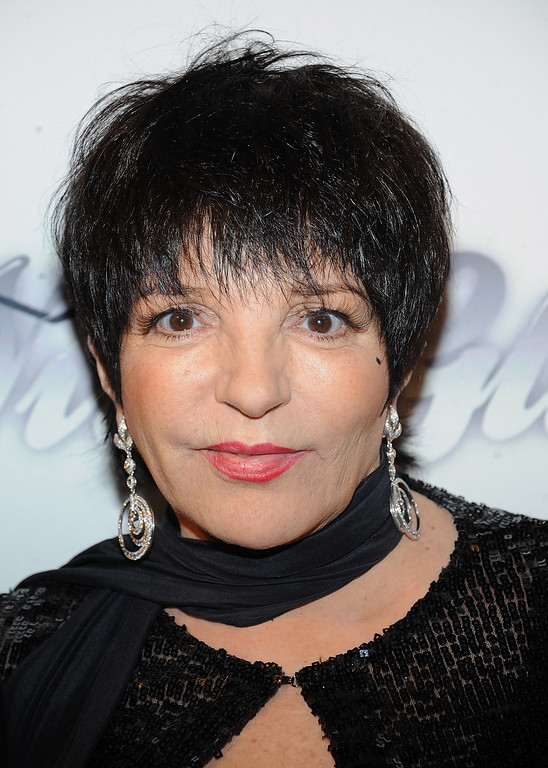 . Actress Liza Minnelli celebrates after selling a date during a silent auction at the amfAR Inspiration Gala at the The Plaza Hotel on Thursday, June 13, 2013 in New York. (Photo by Brad Barketv/Invision/AP)