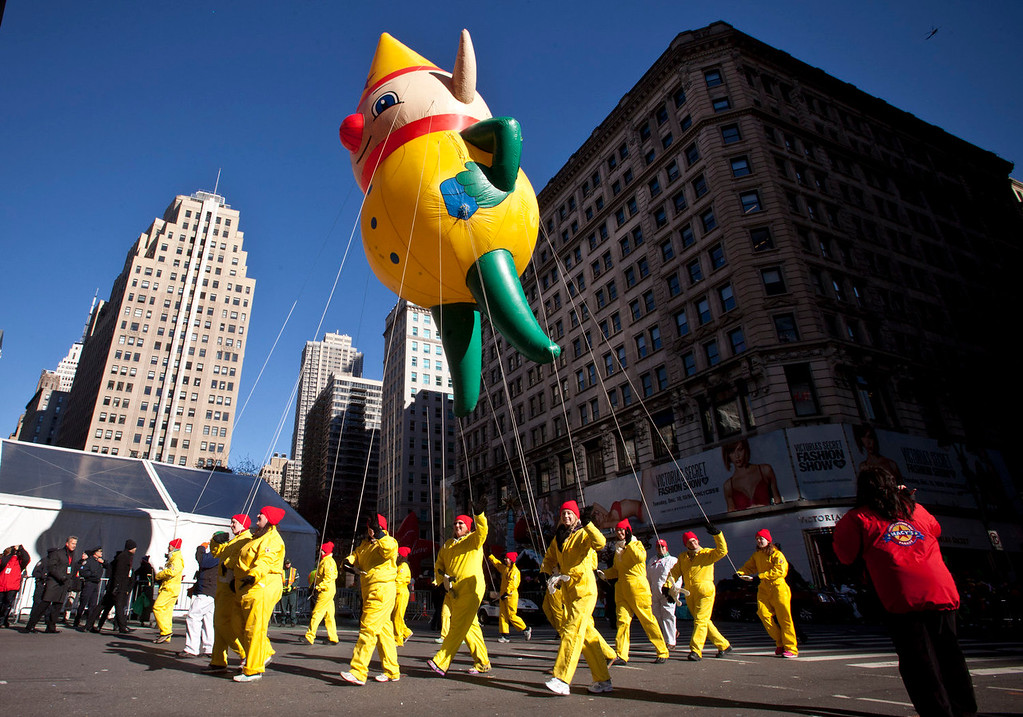 . A Santa\'s Elf balloon floats above the street during the Macy\'s Thanksgiving Day Parade on November 28, 2013 in New York City. Despite earlier concerns about the wind, the balloons flew as planned for the parade. (Photo by Kena Betancur/Getty Images)