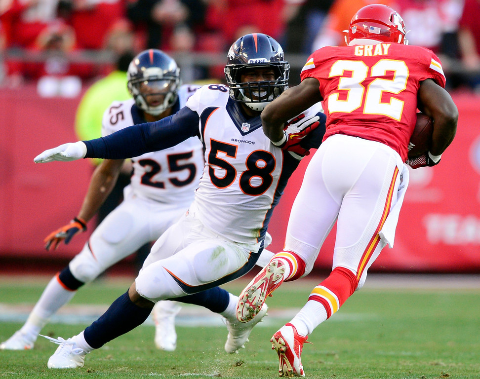 . Von Miller (58) of the Denver Broncos misses a tackle on Cyrus Gray (32) of the Kansas City Chiefs during the first half of action at Arrowhead Stadium. (Photo by AAron Ontiveroz/The Denver Post)