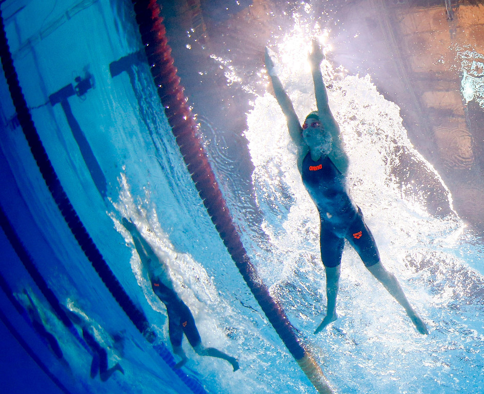 . Lithuania\'s Ruta Meilutyte, right,  swims to win a Women\'s 50m breaststroke semifinal in a new world record time of 29.48 at the FINA Swimming World Championships in Barcelona, Spain, Saturday, Aug. 3, 2013.  (AP Photo/David J. Phillip)