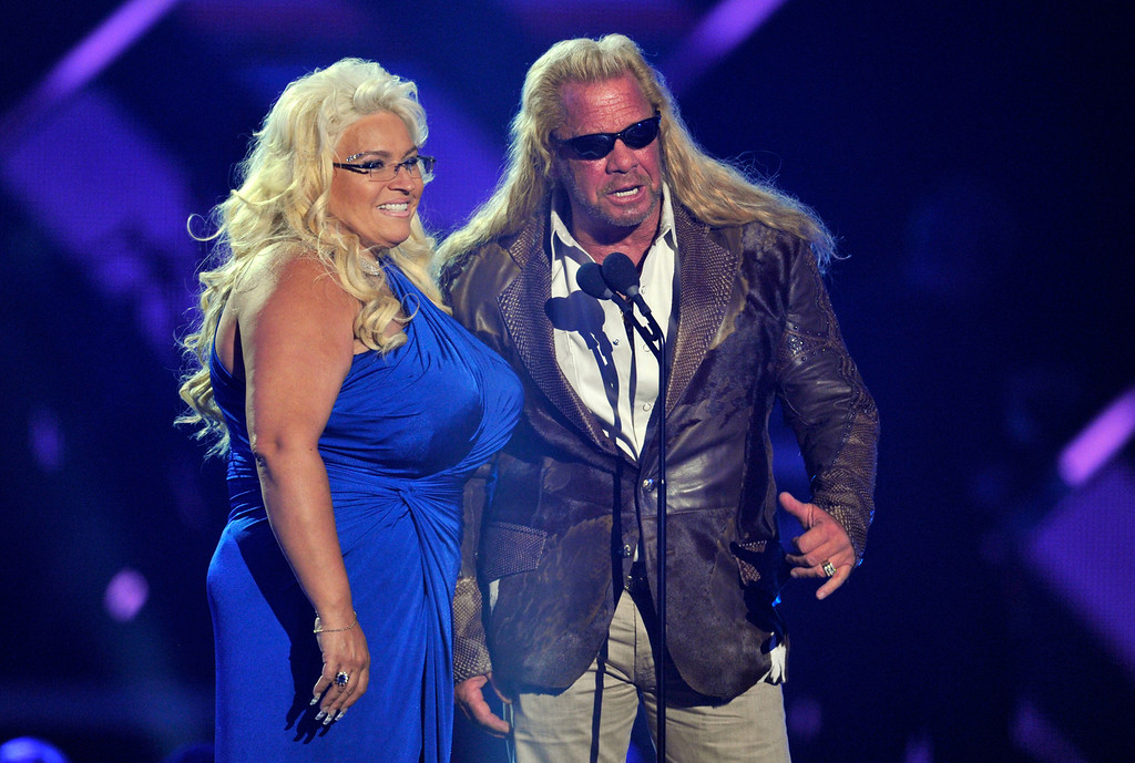 """. Duane \""""Dog\"""" Chapman, right, and Beth Chapman present the award for CMT performance of the year at the 2013 CMT Music Awards at Bridgestone Arena on Wednesday, June 5, 2013, in Nashville, Tenn. (Photo by Donn Jones/Invision/AP)"""