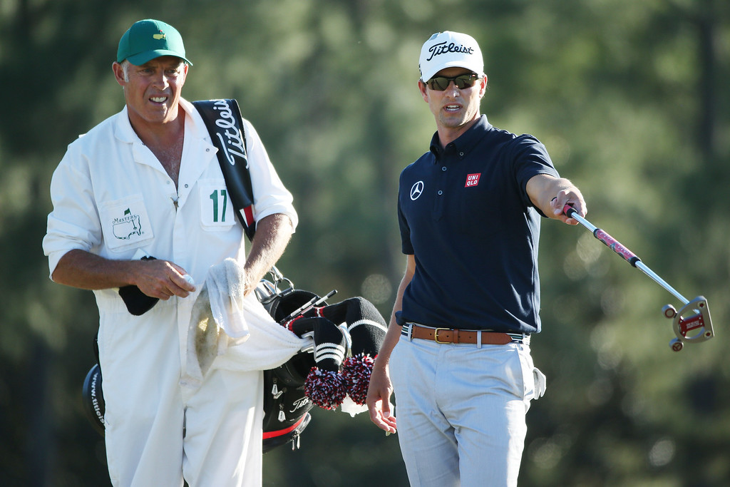 . AUGUSTA, GA - APRIL 13:  Adam Scott of Australia talks with his caddie Steve Williams during the third round of the 2013 Masters Tournament at Augusta National Golf Club on April 13, 2013 in Augusta, Georgia.  (Photo by Andrew Redington/Getty Images)