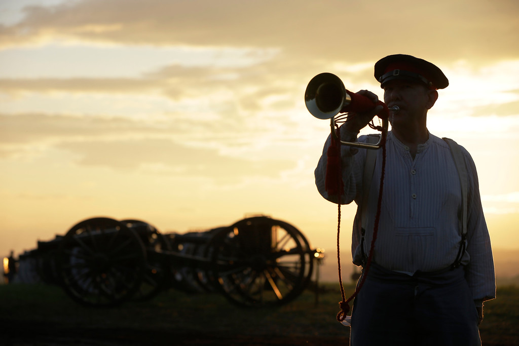 . George Proulx of Cumberland, R.I., plays revelry during ongoing activities commemorating the 150th anniversary of the Battle of Gettysburg, Friday, June 28, 2013, at  at Bushey Farm in Gettysburg, Pa.  Union forces turned away a Confederate advance in the pivotal battle of the Civil War fought July 1-3, 1863, which was also the warís bloodiest conflict with more than 51,000 casualties. (AP Photo/Matt Rourke)