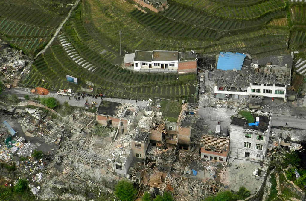 . An aerial view shows houses damaged after a strong earthquake in Lushan county, Ya\'an, Sichuan province, April 20, 2013. At least fifty-six people were killed and more than 500 others injured in the earthquake, according to Xinhua News Agency. REUTERS/China Daily