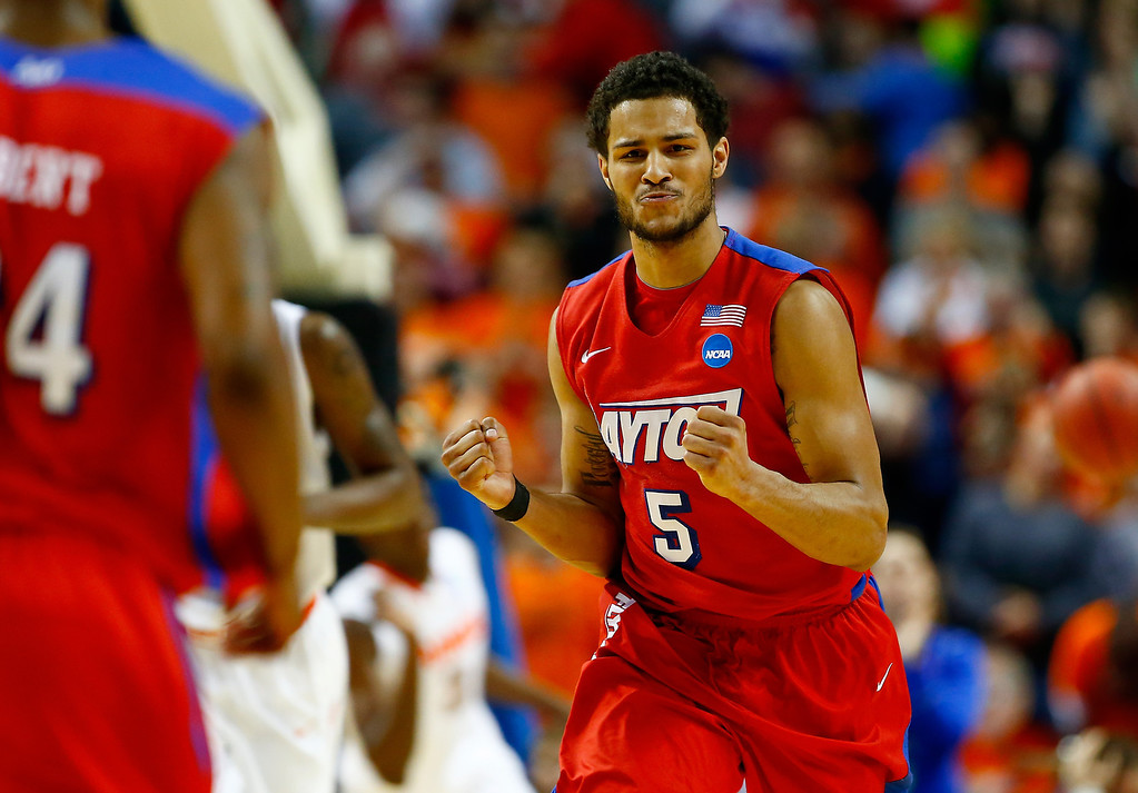 . BUFFALO, NY - MARCH 22: Devin Oliver #5 of the Dayton Flyers celebrates against the Syracuse Orange during the third round of the 2014 NCAA Men\'s Basketball Tournament at the First Niagara Center on March 22, 2014 in Buffalo, New York.  (Photo by Jared Wickerham/Getty Images)