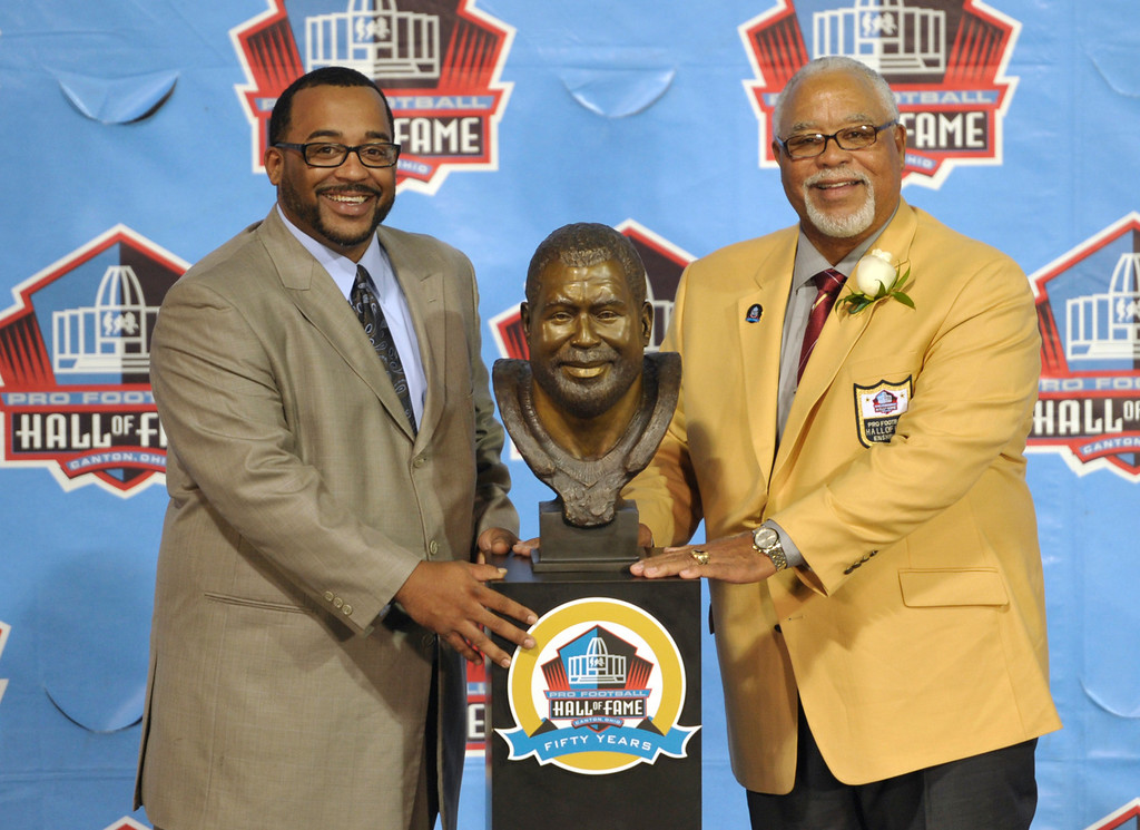 . Inductee Curley Culp, right, poses with his presenter, his son Chad Culp, and a bust of himself during the induction ceremony at the Pro Football Hall of Fame Saturday, Aug. 3, 2013, in Canton, Ohio. (AP Photo/David Richard)
