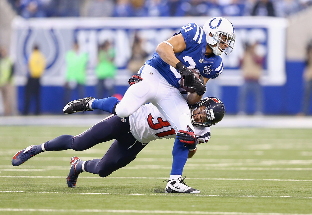 . Donald Brown #31 of the Indianapolis Colts runs with the ball while defended by Shiloh Keo #31 of the Houston Texans at Lucas Oil Stadium on December 15, 2013 in Indianapolis, Indiana.  (Photo by Andy Lyons/Getty Images)