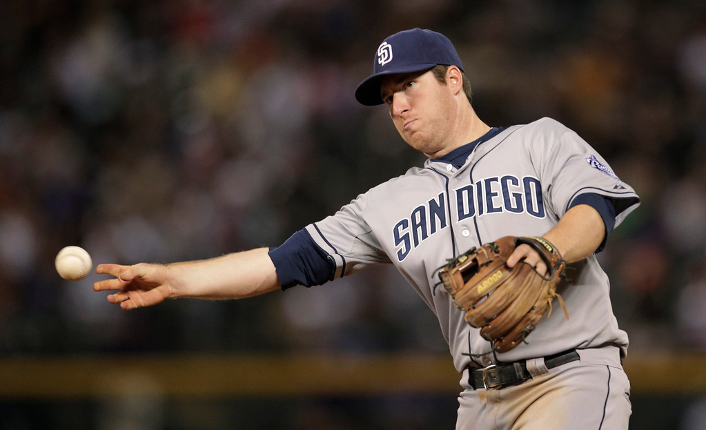 . San Diego Padres second baseman Jedd Gyorko throws out Colorado Rockies\' Charlie Blackmon at first base in the eighth inning of a baseball game in Denver on Tuesday, Aug. 13, 2013. San Diego beat Colorado 7-5.(AP Photo/Joe Mahoney)