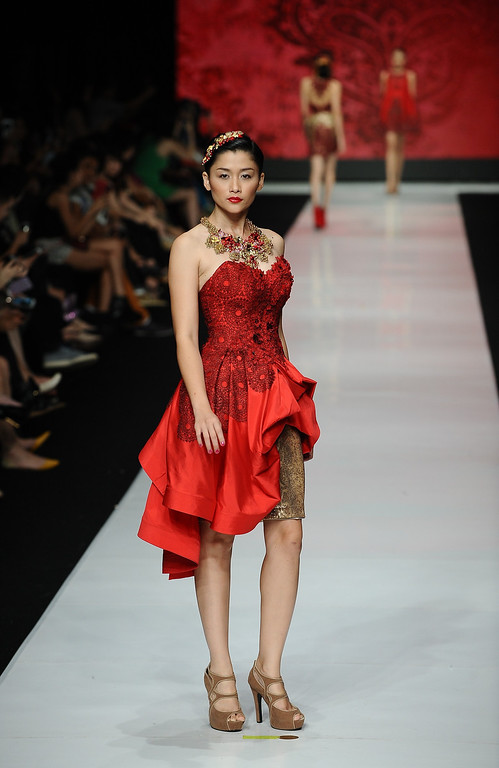 . Models showcase designs by Imelda Kartini on the runway at the Esmod Jakarta show during Jakarta Fashion Week 2014 at Senayan City on October 21, 2013 in Jakarta, Indonesia.  (Photo by Robertus Pudyanto/Getty Images)