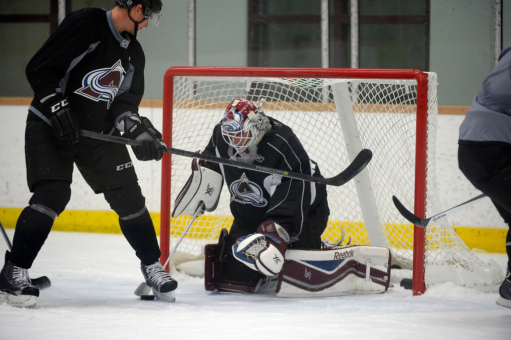 . Colorado Avalanche G J.S. Giguere (35) makes a save during practice September 9, 2013 at Family Sports Ice Arena. (Photo By John Leyba/The Denver Post)